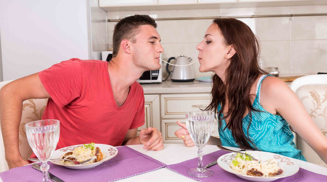 Young Couple Having Romantic Dinner at Home