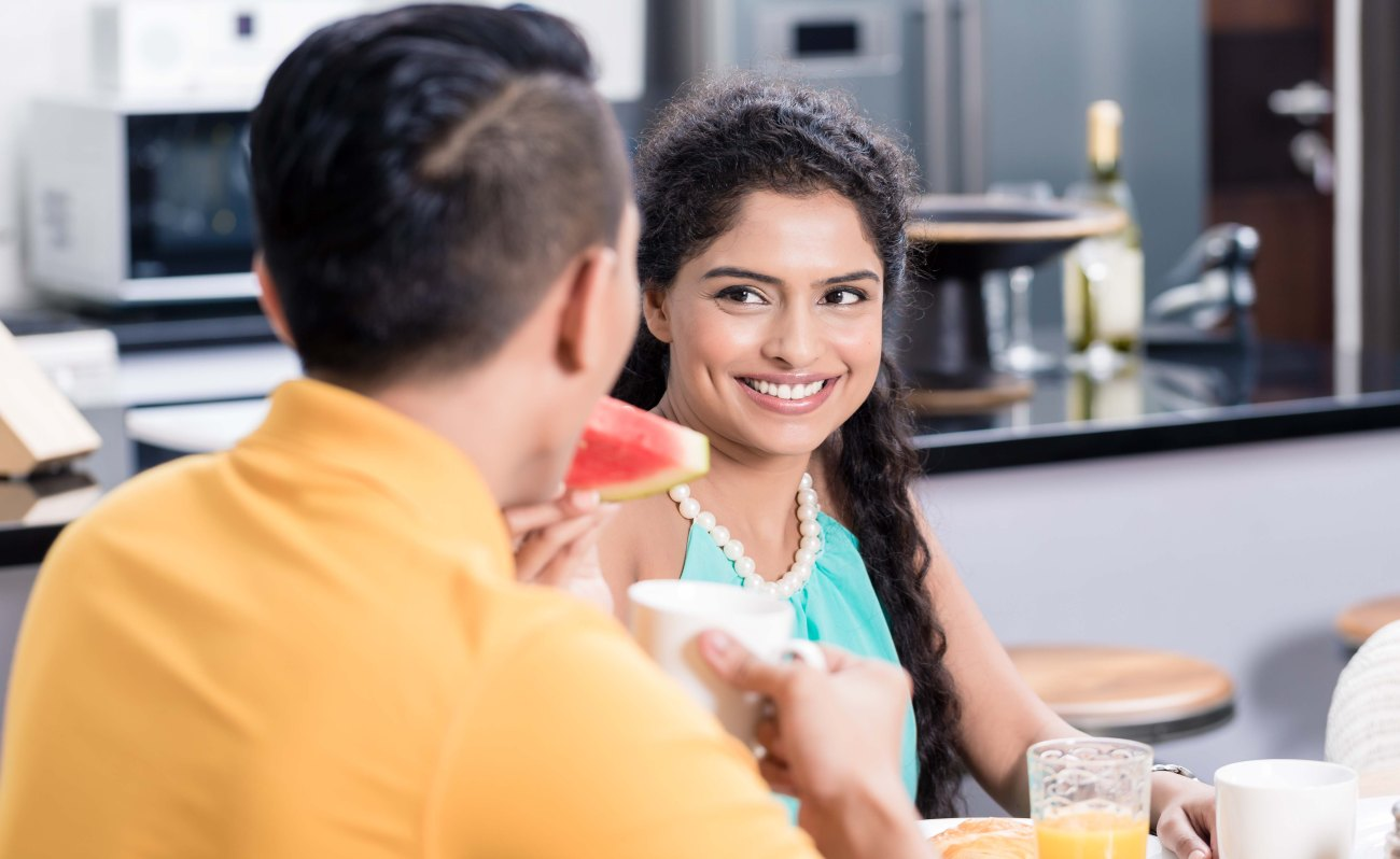 Couple, Indian woman and man, having breakfast