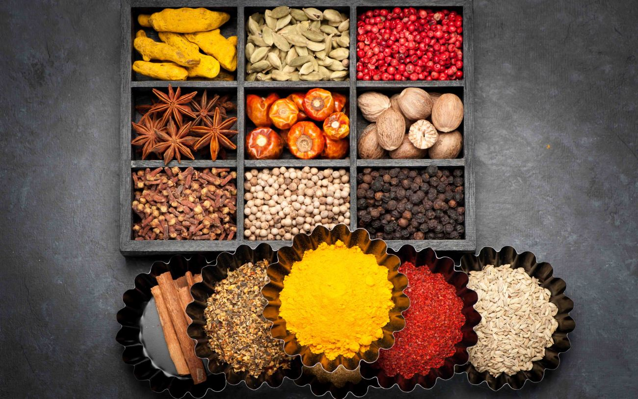 Spices, spicy, seasonings  in wooden box, top view. Black grunge