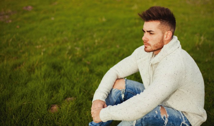 Attractive guy with beard in the meadow