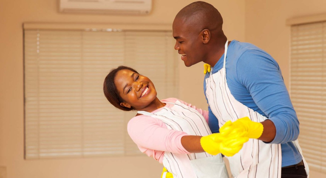 african american couple dancing in their new home