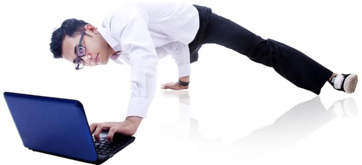 Businessman breakdancing and working