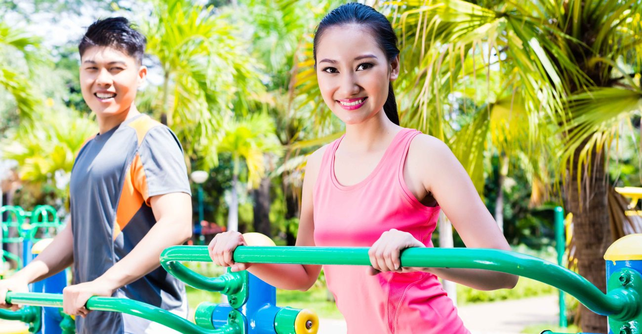 Asian Chinese sport friends in outdoor fitness gym