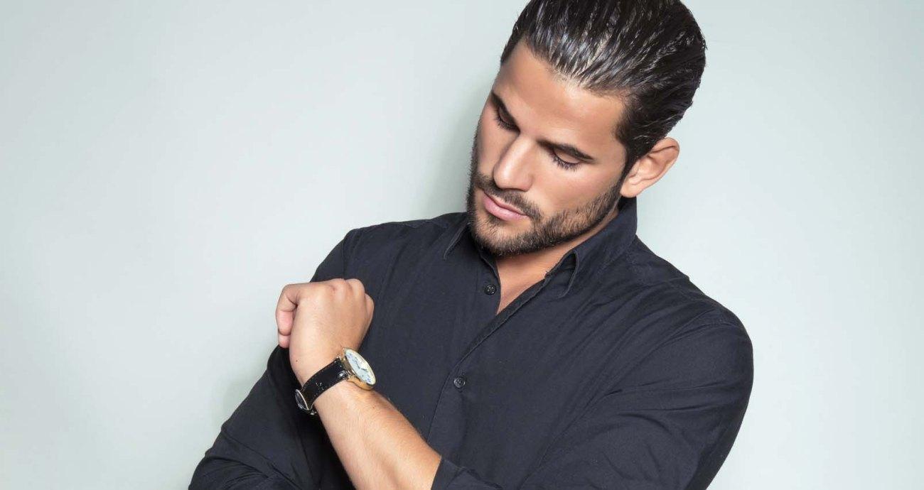 handsome young man in black dress shirt wearing a wristwatch