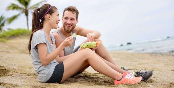 Salad - healthy fitness couple eating food