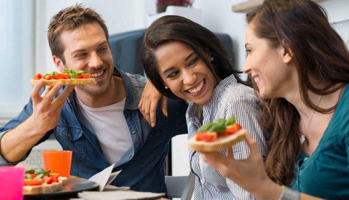 Friends eating bruschetta